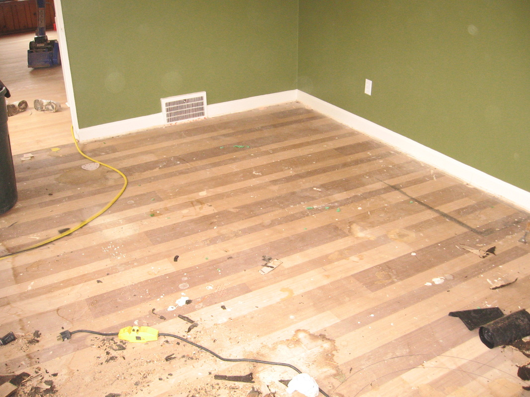 We Started By Removing The Cork Flooring With A Power Ser